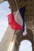Flag underneath the Arc de Triomphe Stock Photos