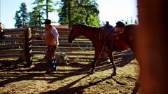 American male Cowboy in corral with horse and saddle Wild West - stock footage