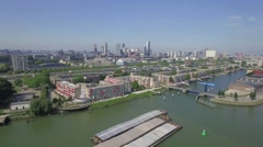 Aerials Rotterdam Fly out over river leaving city Stock Footage