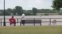 Two Men Fishing on Mississippi River Stock Footage