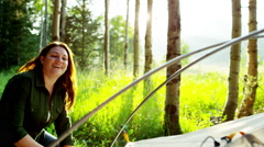 Happy Caucasian mum and son building tent in forest on holiday outdoor - stock footage