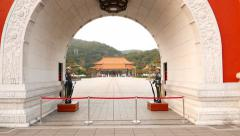 Pailou at Taipei Martyr's Shrine complex, tilt down to archway, guards stand Stock Footage