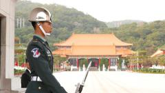 Military police officer guards Martyr's Shrine, portrait, side view Stock Footage