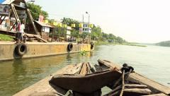 Shot from the bow of a traditional passenger boat as it docks on the banks of Stock Footage