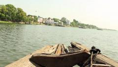 Shot from the bow of a traditional passenger boat as it plies across the Rive Stock Footage