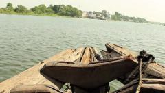 Shot from the bow of a traditional passenger boat on the River Ganges Stock Footage