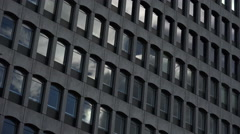 corporate building timelapse: clouds moving over the windows of the building  - stock footage