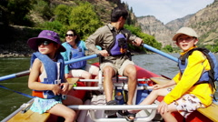 Happy American Caucasian family rafting on Colorado River on vacation outdoors - stock footage