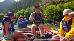 Caucasian family having fun together rafting on Colorado River on holiday - stock footage
