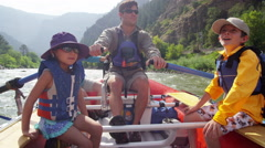 Happy Caucasian family enjoying rafting on Colorado River on vacation outdoor - stock footage