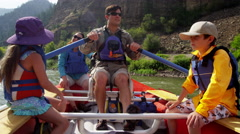 American Caucasian family having fun together rafting on Colorado River - stock footage
