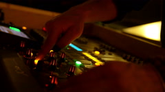 Hand working on the audio mixer  Stock Footage