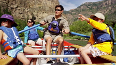 Happy Caucasian family enjoying rafting on Colorado River on vacation outdoor Stock Footage