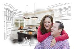 Happy Laughing Couple With Kitchen Design Drawing and Photo Behind. - stock photo
