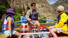 Happy family having fun adventure trip on Colorado River on holiday outdoors - stock footage