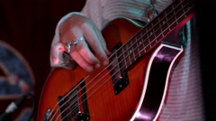 Closeup footage on hand playing electric bass guitar Arkistovideo