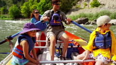 Happy American Caucasian family rafting on Colorado River on holiday outdoors - stock footage