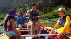 Happy American family rafting on Colorado River on Summer holiday outdoor - stock footage