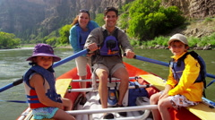 Portrait of happy American Caucasian family enjoying rafting on Colorado River - stock footage