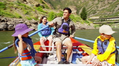 Happy Caucasian family having fun together rafting on Colorado River - stock footage