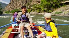 Happy family having fun adventure trip on Colorado River outdoors - stock footage
