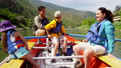 American Caucasian family having fun adventure trip on Colorado River on holiday - stock footage
