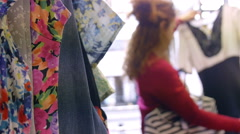 Young woman searching for a new clothes in a shop Arkistovideo