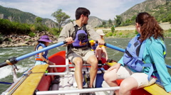 Happy American Caucasian family rafting on Colorado River on vacation outdoors Stock Footage