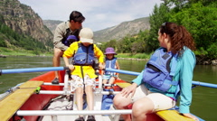 Happy Caucasian family having fun adventure trip on Colorado River on holiday - stock footage
