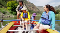 Happy Caucasian family rafting on Colorado River on holiday outdoors - stock footage