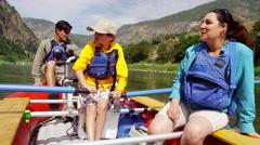 American Caucasian family having fun adventure trip on Colorado River outdoors Stock Footage