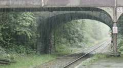 Rain on the countryside station: old england station: afternoon raining Stock Footage