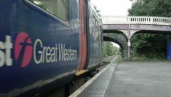 First great western train starting from a local train station: Bristol, UK Stock Footage