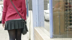 Young woman walking for shopping down the sidewalk (pavement) -slow motion- Stock Footage