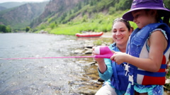 Caucasian mother and daughter having adventure fishing on Colorado River outdoor - stock footage
