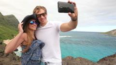 Couple tourists taking self portrait with camera phone on Hawaii, Oahu, Makapuu - stock footage