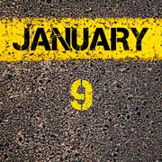 9 January calendar day over road marking yellow paint line Stock Photos