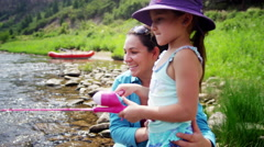 Happy American mother and daughter having fun fishing on Colorado River outdoors - stock footage