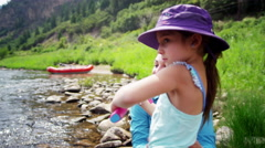 Happy Caucasian mum and girl fishing on Colorado River on vacation outdoor Stock Footage