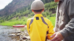 Happy Caucasian son learning fishing with father on Colorado River on vacation - stock footage