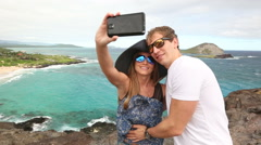 Stock Video Footage of Couple tourists taking self portrait with camera phone on Hawaii, Oahu, Makapuu