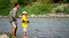 Happy Caucasian son learning fishing with father on Colorado River on holiday - stock footage