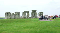 People visiting stonehenge prehistoric monument Stock Footage