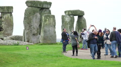 Tourist people visiting stonehenge Stock Footage