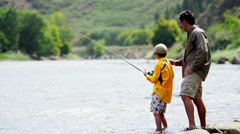 Confident Caucasian father and son fishing on Colorado River on vacation outdoor - stock footage