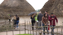 stonehenge Neolithic dwellings in the archeological site - stock footage