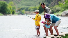 Happy American Caucasian family fishing on Colorado River on holiday outdoors - stock footage