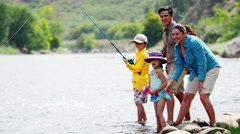 Happy Caucasian family having adventure together fishing on Colorado River - stock footage