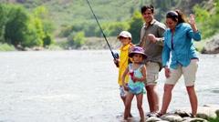 Portrait of happy American Caucasian family enjoying fishing on Colorado River Stock Footage