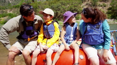 Happy American Caucasian family rafting on Colorado River on holiday outdoor - stock footage